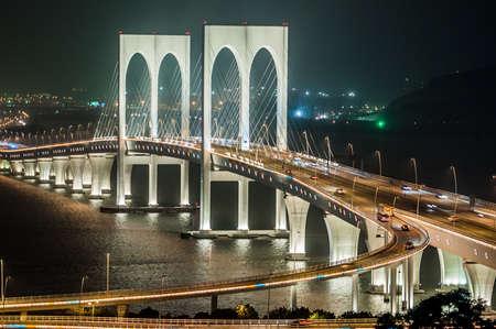 the famous bridge connecting Macau and Taipa at night photo