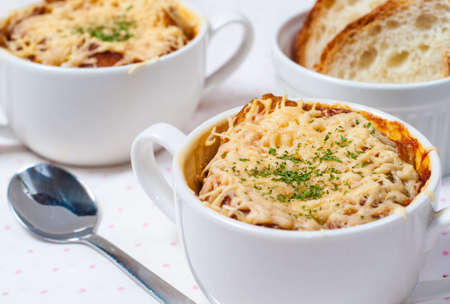 baked onion soup with cheese and bread in french style photo