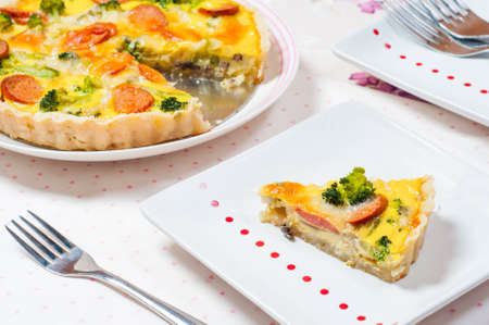 brocolli: sausage brocolli cheese pie with fork