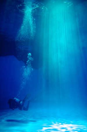 deep sea diver: frogman in water