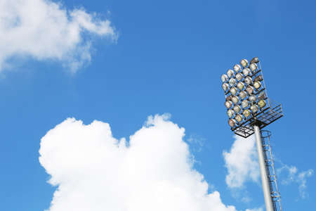 A football stadium sportlight with blue sky photo
