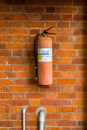 foam safe: Fire Extinguisher on brick wall Stock Photo
