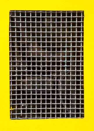 Wire metal net border yellow background photo