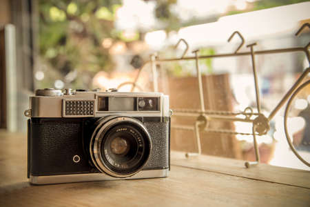 vintage camera: Retro camera on wooden table