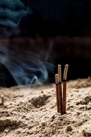 incense sticks: Incense sticks burning