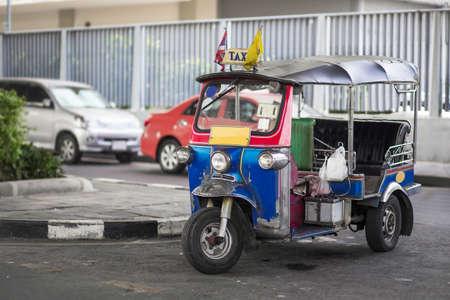 tuk: A three wheeled tuk tuk taxi on a street in the Thai capital