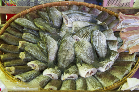 fish tail:  Trichogaster pectoralis arrange on rattan in market in asian food thai food (Fish) Stock Photo