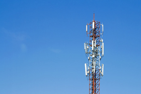 Mobile phone communication tower transmission  signal with blue sky background and antenna Stock Photo