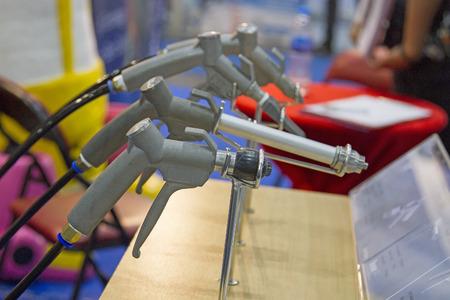 Many sandblasting guns are located on the table. Stock Photo