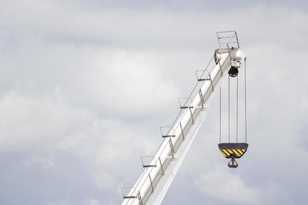 White lifting crane with black lifting hoop