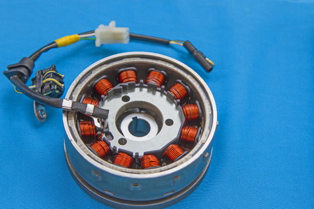 Kit magneto flywheel stator on a blue background