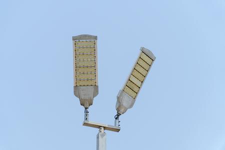 LED illumination tower with blue sky background Standard-Bild