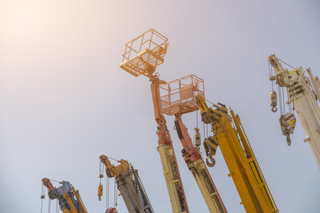 Many crane lift or mobile on construction industrial Stock Photo