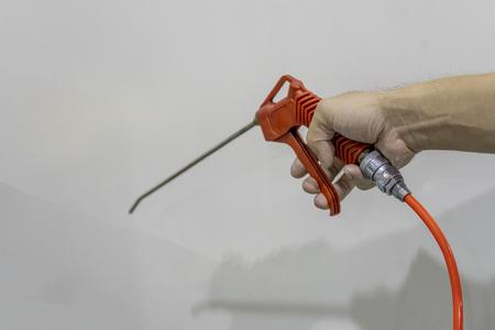 Air blow gun of orange use handle keep.