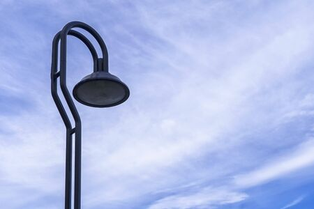Street lamp or light pole with blue sky background
