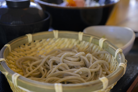 Japanese udon noodles in a bamboo container