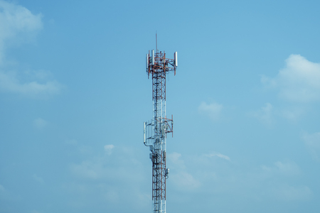 Mobile phone tower transmission  signal blue sky background and antenna