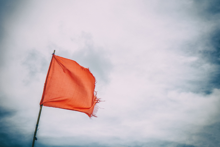 Red flag warning flags wind blue sky 스톡 콘텐츠