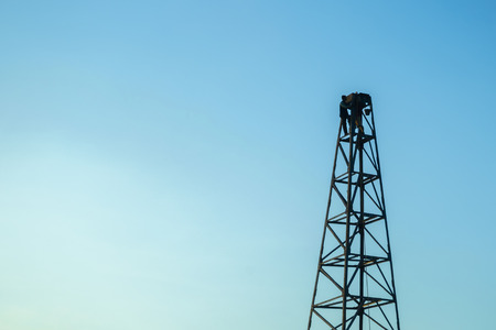 Pile rig construction worker building in evening Stock Photo