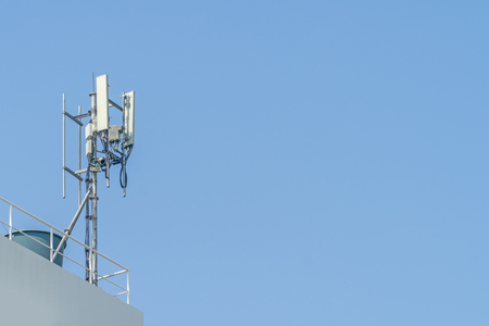 Cellular phone towers are on the rooftop of the building. Stock Photo