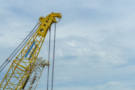 Crane lift yellow on blue sky background