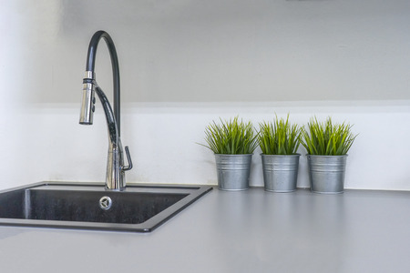 Kitchen sink and faucet in house interior
