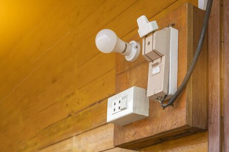 Cutouts and power plugs on old wooden walls Stok Fotoğraf