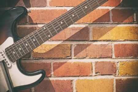 Guitar on a brick wall for life style