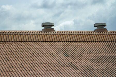 Ventilation on the old orange roof background