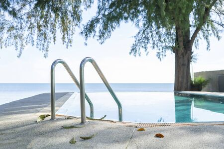 Pool with sea under the trees relax