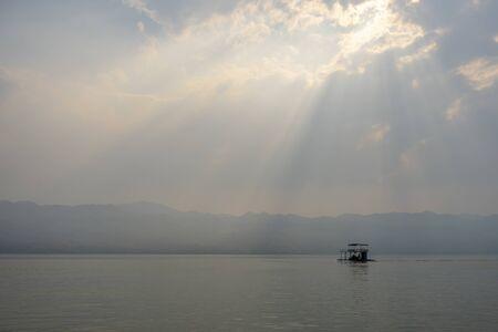 Raft in the lake with sunset or sunrise 版權商用圖片