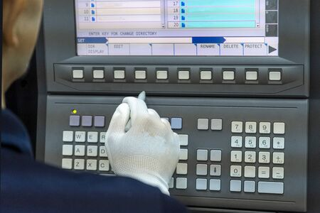 CNC Machine control panel with hand the press.