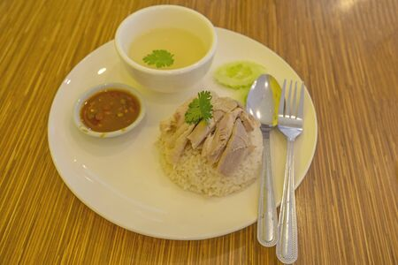 Chicken rice with soup, salad and sauce