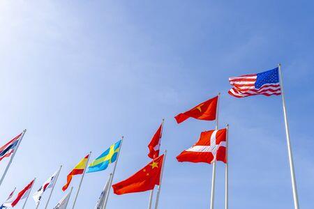 Flagpole international global with blue sky background  Stock Photo