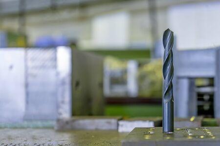 Black drill bit on the work table industria Stock Photo