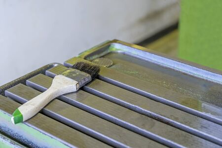 Cleaning brush on cnc machine table workshop