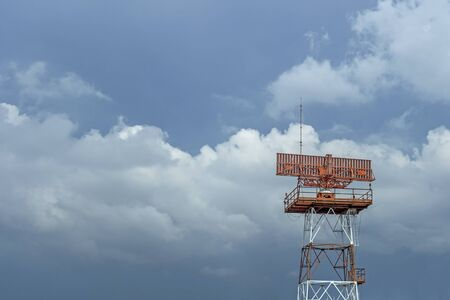 Airport radar red-and-white with rain clouds background Stock Photo