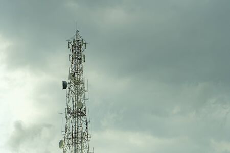 Signal tower or signaling poles with rain clouds