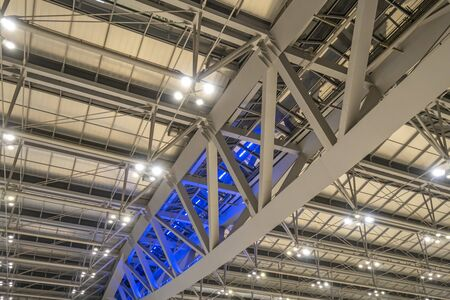 Large steel frame in the building with spotlights. Фото со стока