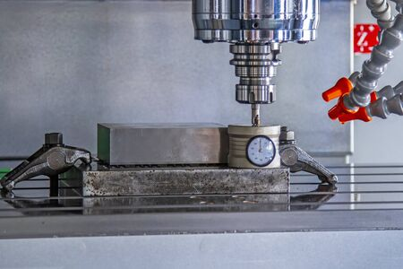 CNC machining with machine tool setting on box set beforecutting raw material for business Stock Photo