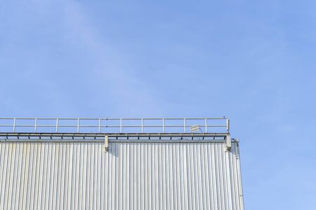 Some parts of the warehouse and blue sky background and copy space Stock Photo