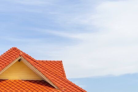 Orange tile roof with a blue sky background and clouds and copy space Stock Photo