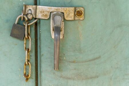Padlock with rusty chains and green  background vintage style