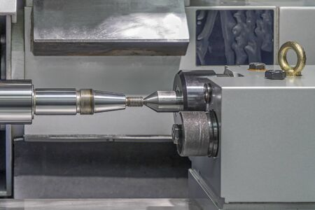 Screw lathe machine, lathe threading machine, turning machine cutting screw threads on a lathe tool processing in a workshop.