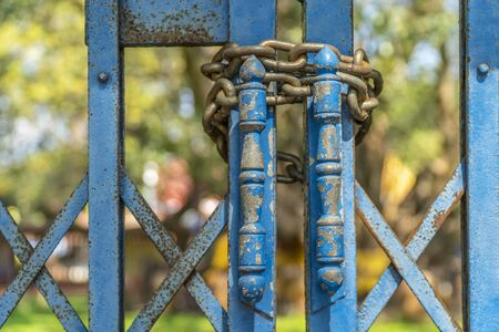 Iron blue door with the chain lock, Abstract background Stock Photo