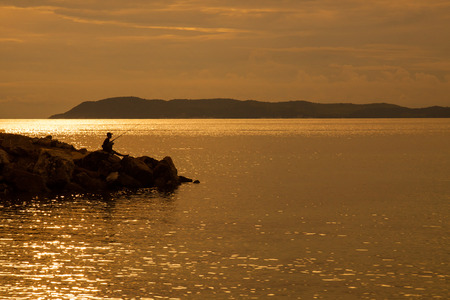 A child fishing in the evenings photo