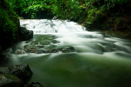 Waterfall in a forest in the rainy season photo