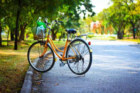 exert: Yellow bicycle parking in the garden Stock Photo