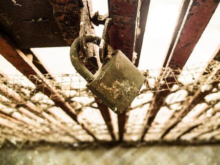 unblock: Old steel door padlock locked