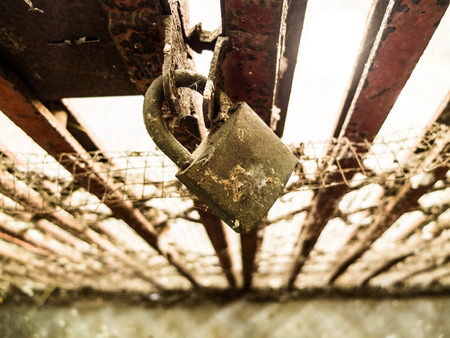 unbar: Old steel door padlock locked